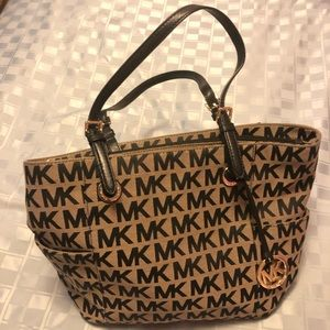 Michael Kors purse used  in good condition.